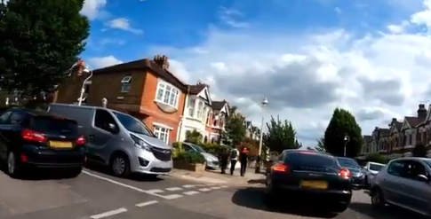 A picture showing a junctions in what was LTN jammed with cars with a pickup truck parked on the corner blocking a dropped kerb